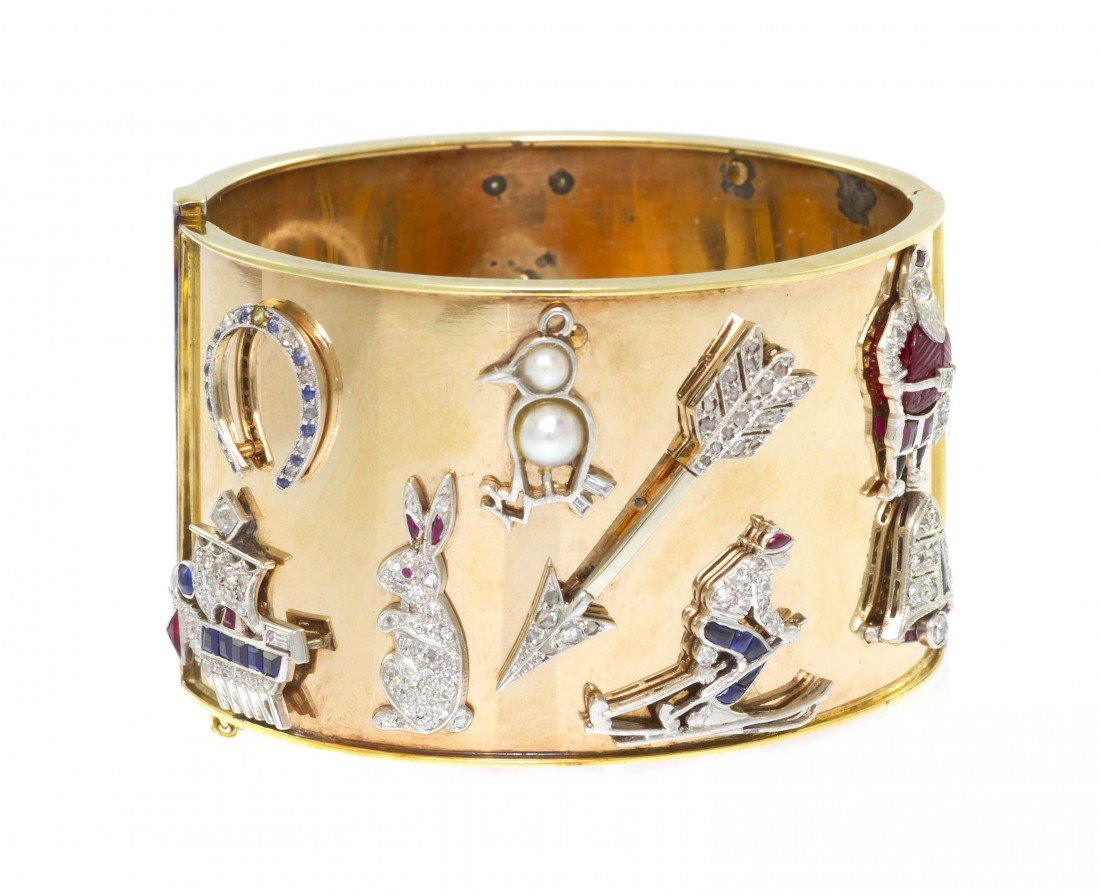 61: A Yellow Gold Bangle Bracelet with Attached Art Dec