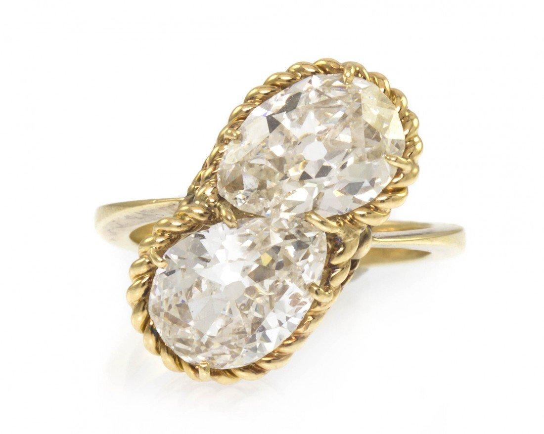 63: A Yellow Gold and Antique Cut Diamond Toi et Moi Ri