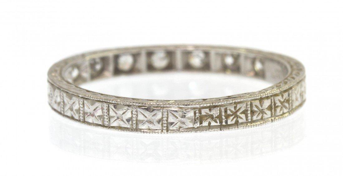 65: An Art Deco Platinum and Diamond Band Ring, Circa 1