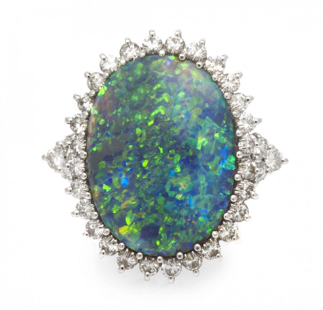 69: A Platinum, Diamond and Black Opal Ring, 5.70 dwts.