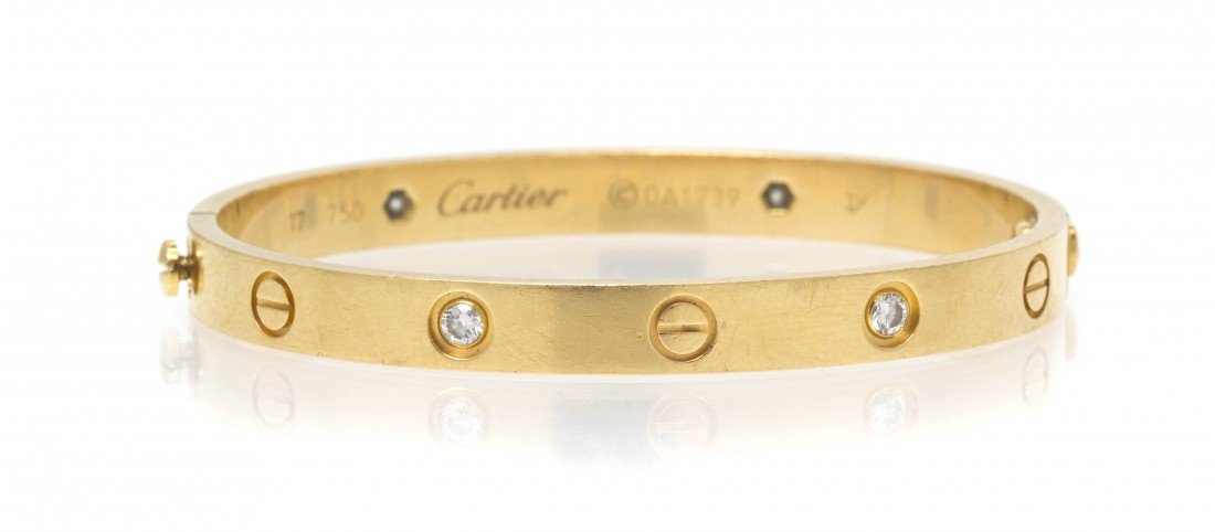 236: An 18 Karat Yellow Gold and Diamond Love Bracelet,