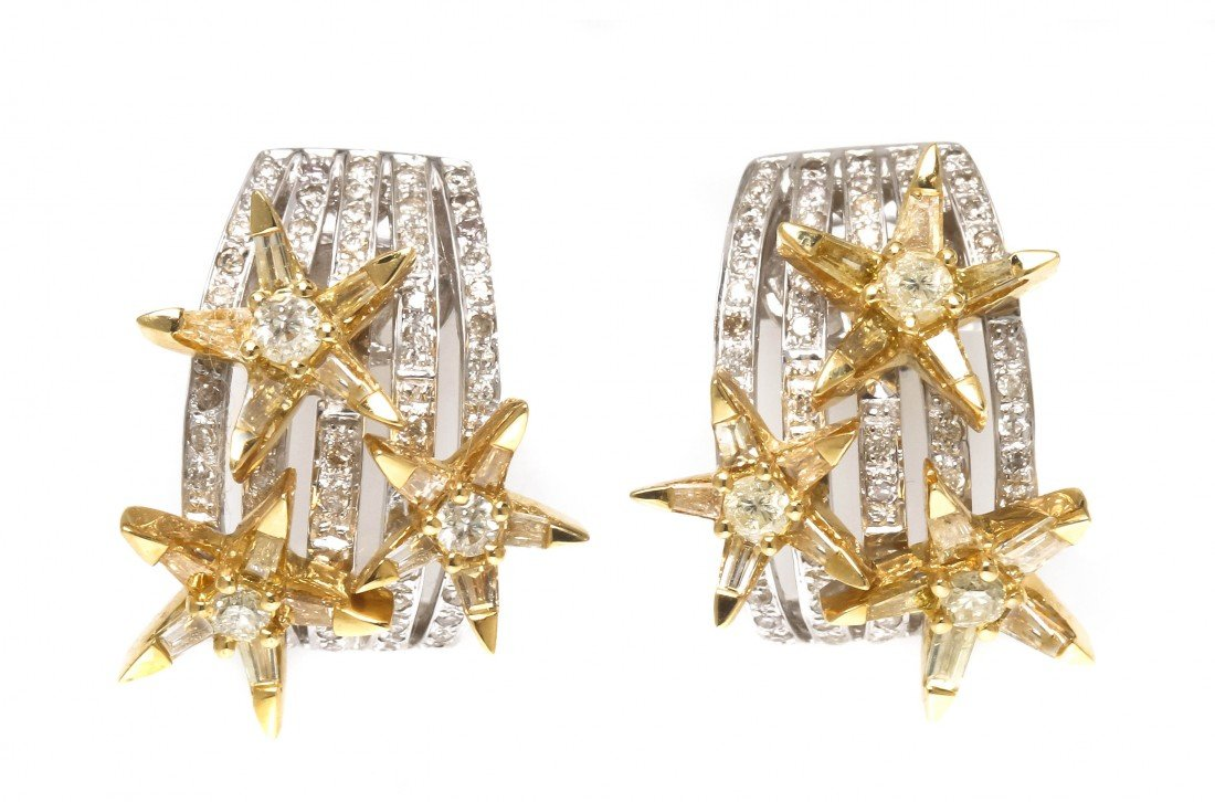 293: A Pair of 18 Karat Gold and Diamond Earrings, 10.9