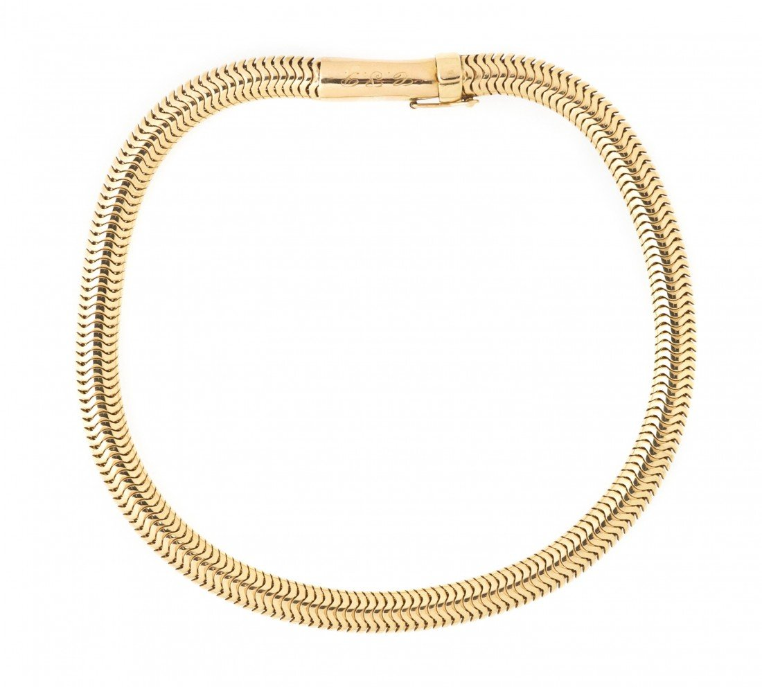 294: A 14 Karat Yellow Gold Snake Chain Necklace, 56.50