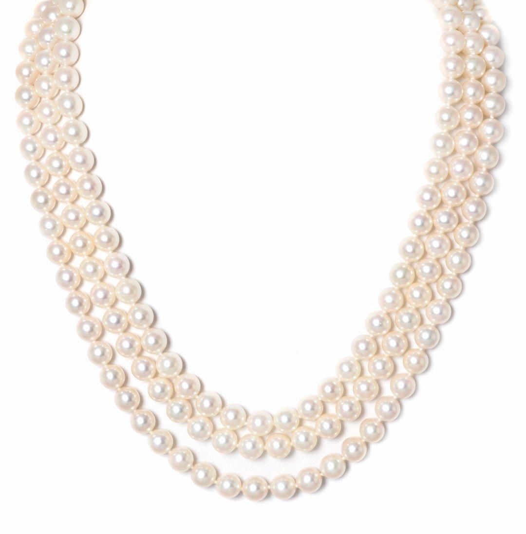 300: A Triple Strand Cultured Pearl Necklace, Mikimoto,