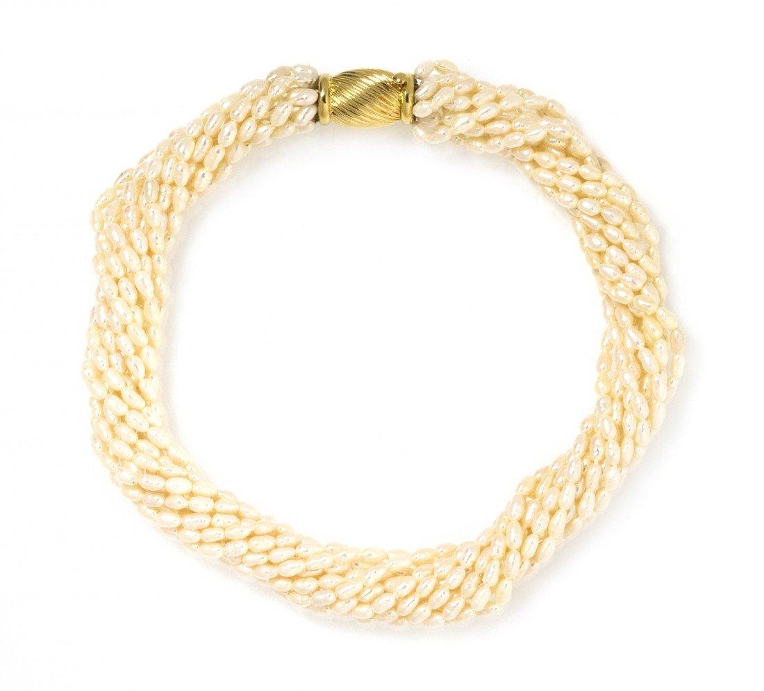 302: A 14 Karat Yellow Gold and Multi Strand Keishi Pea