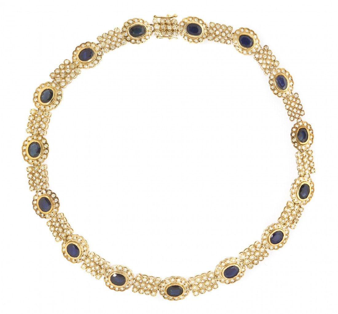 303: A 14 Karat Yellow Gold, Sapphire, and Diamond Neck