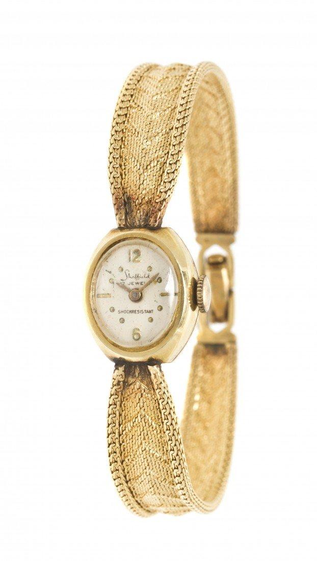 304: A 14 Karat Yellow Gold Mechanical Wristwatch, Shef