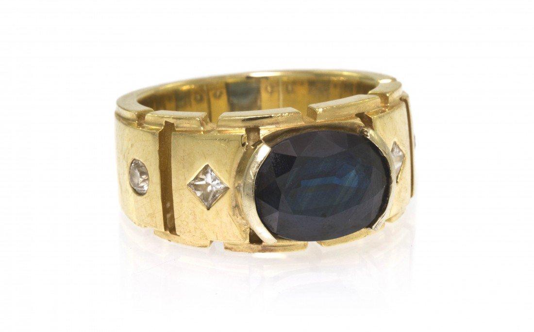 305: A 14 Karat Yellow Gold, Sapphire and Diamond Ring,