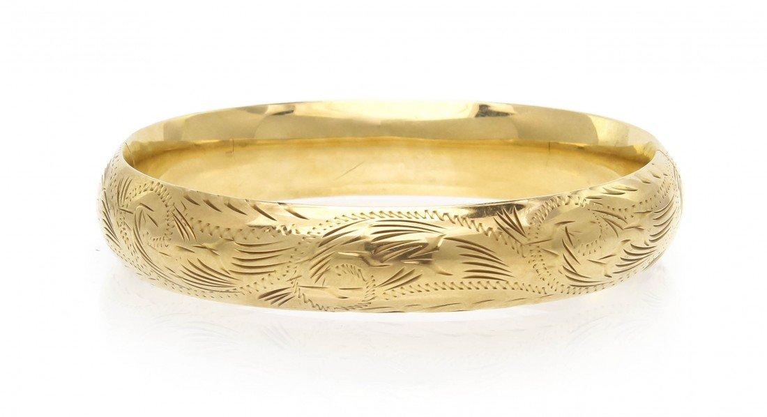 306: A 14 Karat Yellow Gold Hinged Bangle Bracelet, 11.