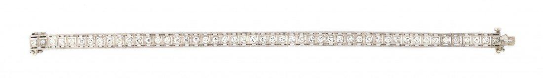 379: A 14 Karat White Gold and Diamond Line Bracelet, 1