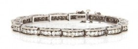 A 14 Karat White Gold And Diamond Link Bracelet, 1