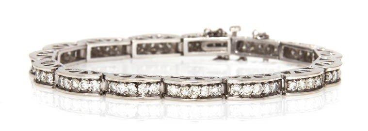 380: A 14 Karat White Gold and Diamond Link Bracelet, 1