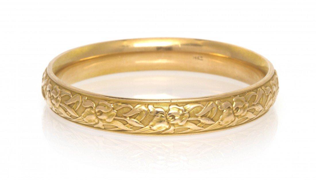 382: A 14 Karat Yellow Gold Foliate Motif Bangle Bracel