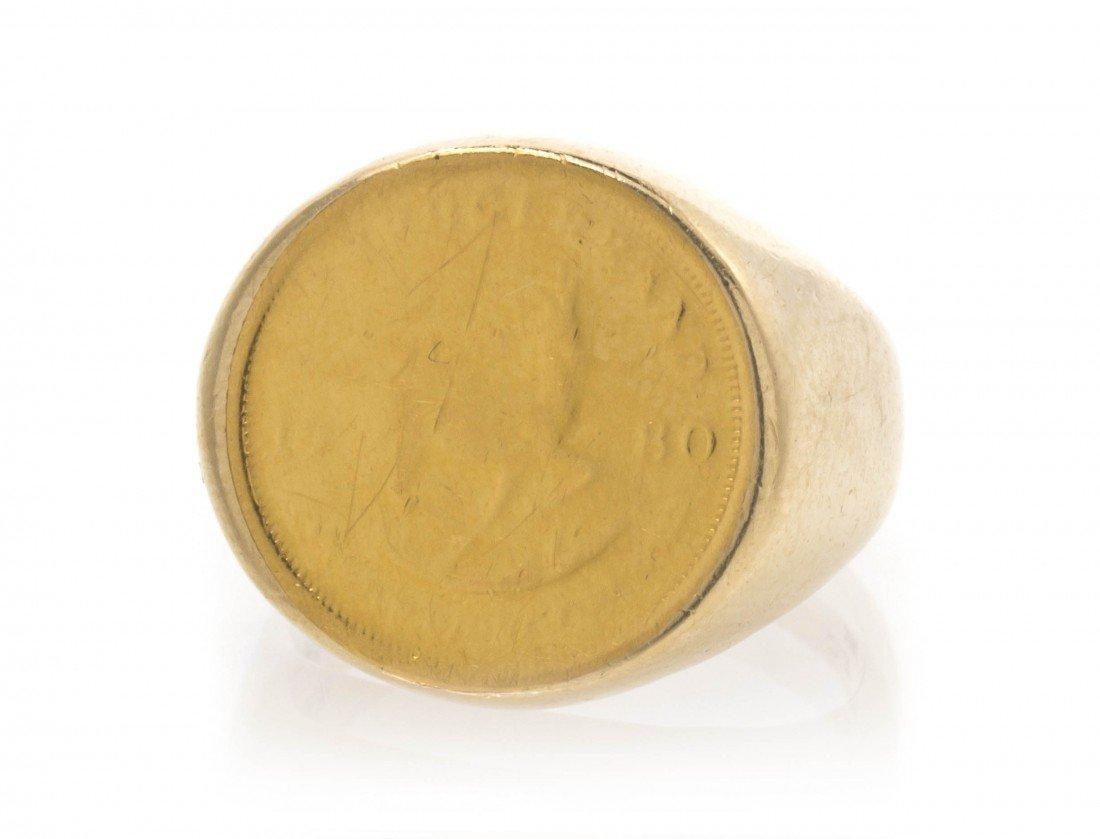 384: A 14 Karat Yellow Gold Coin Ring. 6.50 dwts.