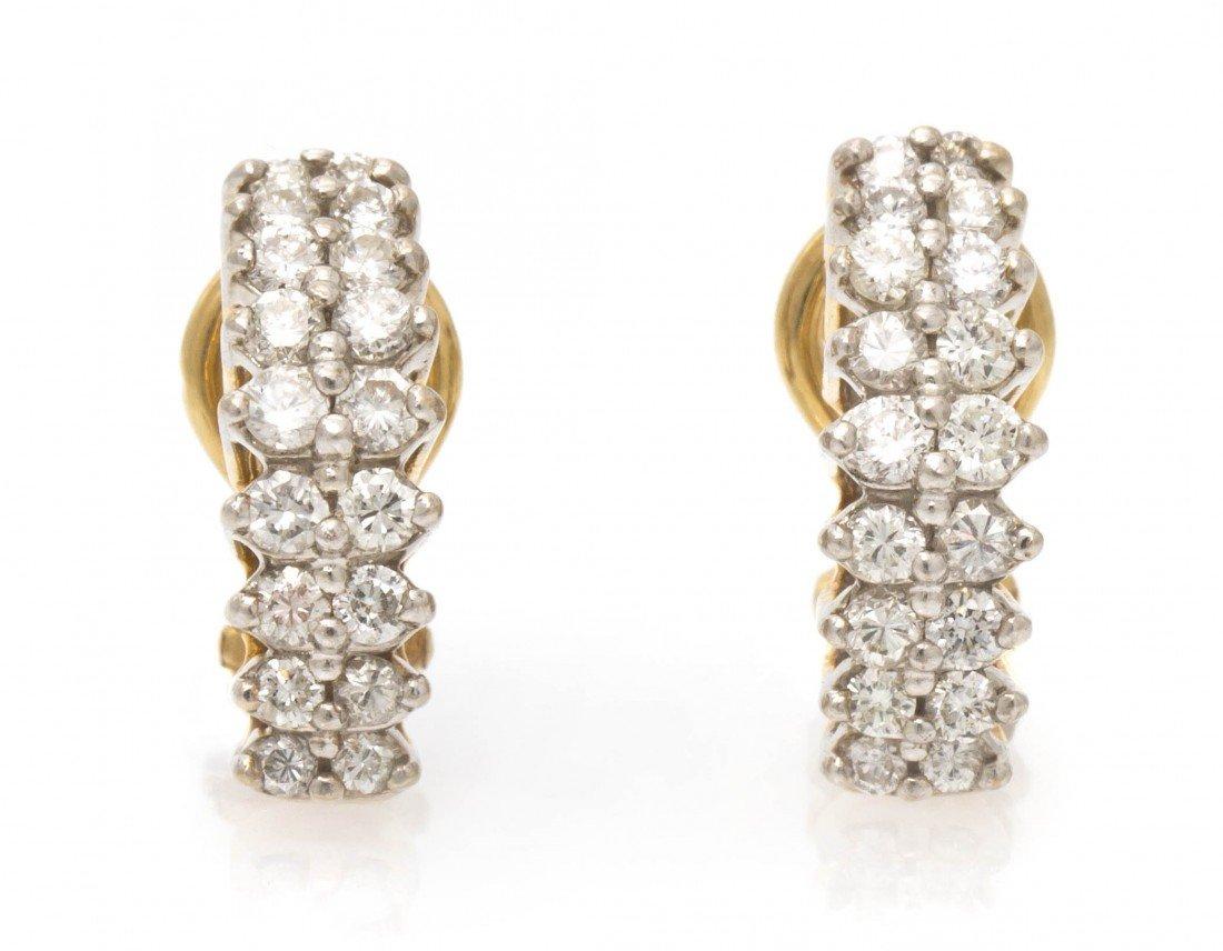385: A Pair of 14 Karat Yellow Gold and Diamond Earclip