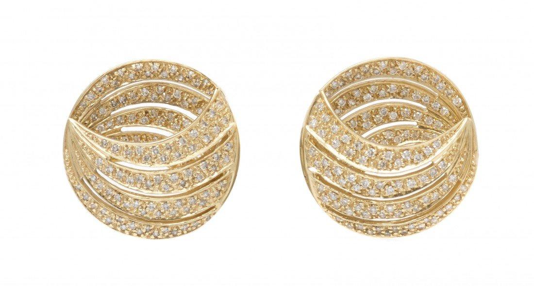 395: A Pair of 14 Karat Yellow Gold and Diamond Earclip