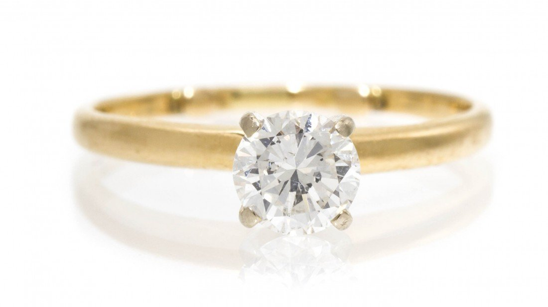 397: A 14 Karat Yellow Gold and Diamond Solitaire Ring,