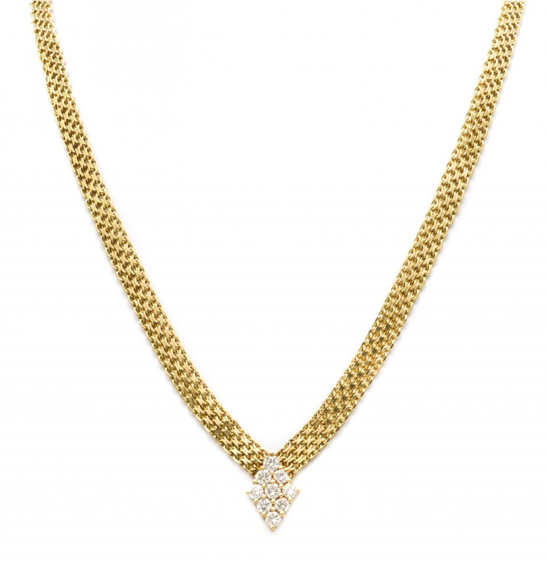 398: A 14 Karat Yellow Gold Diamond and Mesh Necklace,