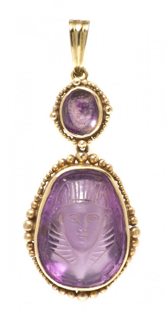 480: An Antique Yellow Gold and Carved Amethyst Pendant