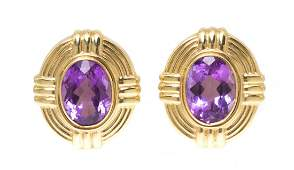 520 A Pair of 14 Karat Yellow Gold and Amethyst Earcli