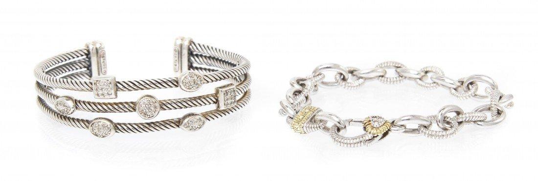 544: A Group of Sterling Silver and Diamond Bracelets,