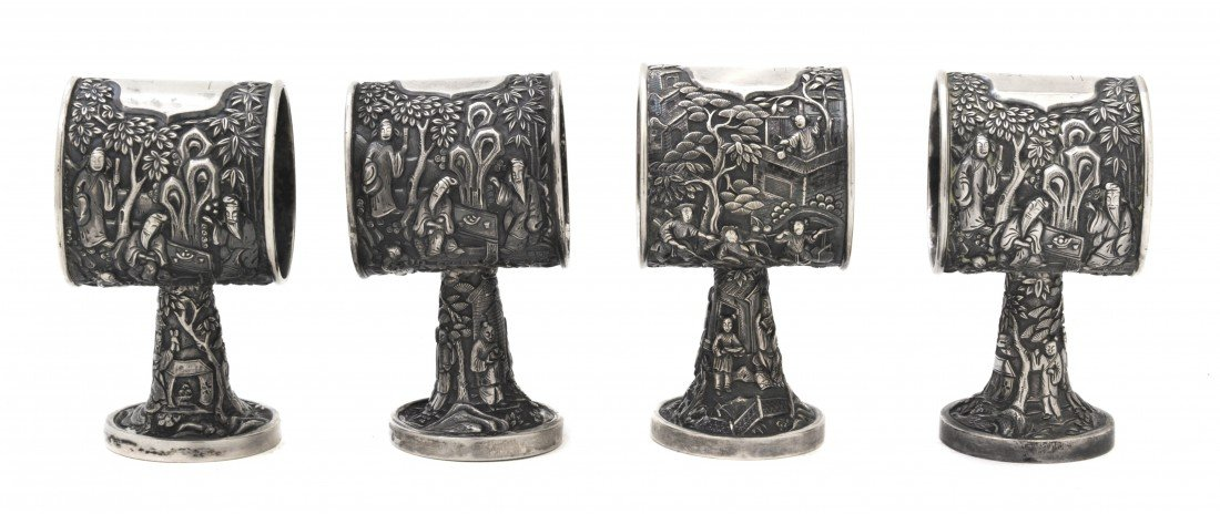 118: A Set of Four Chinese Export Silver Napkin Rings,