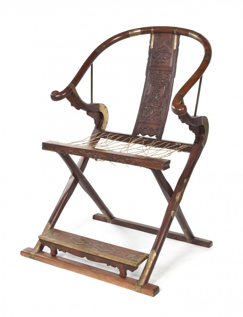 128: A Chinese Huanghuali Horseshoe-Back Folding Chair,