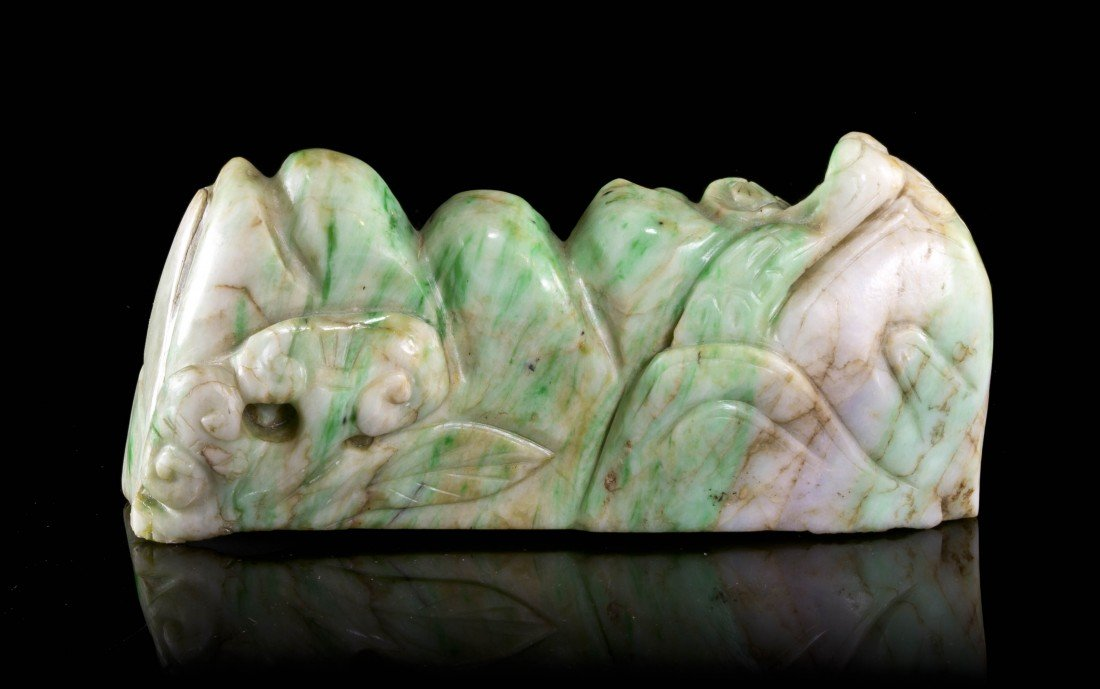 439: A Carved Jadeite Brush Rest, Length 6 inches.