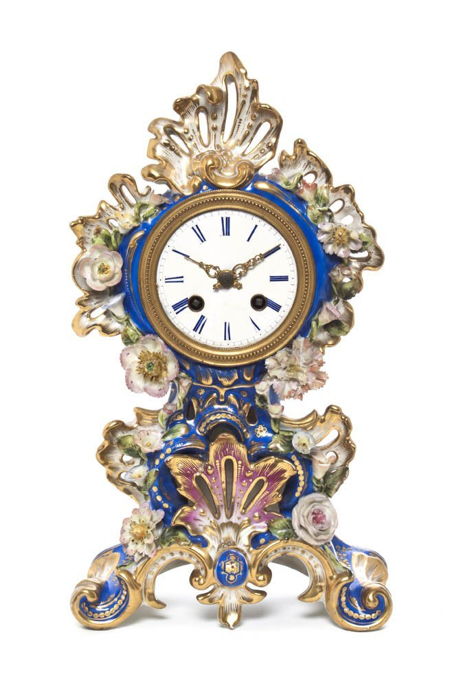 9: A French Enameled Porcelain Clock, Height 14 inches.