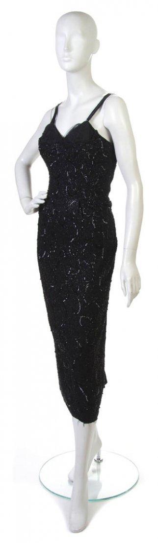 3: A Ceil Chapman Black Beaded Sheath Evening Dress.