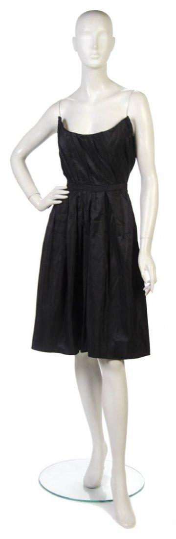 16: A Mila Schon Black Silk Cocktail Dress, Size 40.