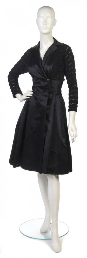 18: A Dan Werle Black Evening Dress.