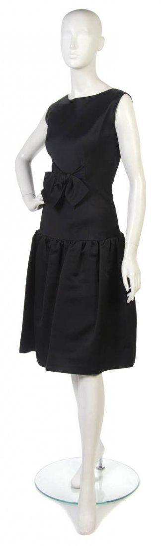 20: A Norman Norell Black Silk Cocktail Dress,