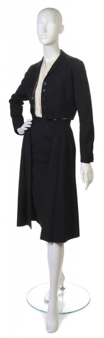 23: A Pauline Trigere Three Piece Black Skirt Suit.