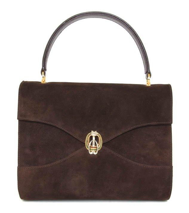 357: A Gucci Brown Suede Handbag. 11 x 8 inches.
