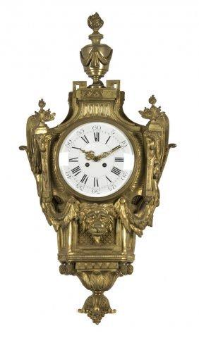 8: A Louis XV Style Gilt Bronze Cartel Clock, Height 30