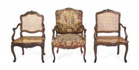24: A Group of Three Louis XV Style Mahogany Fauteuils,