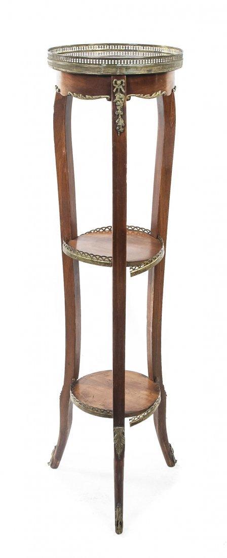 85: A Louis XVI Style Gilt Metal Mounted Pedestal Table