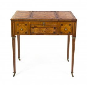 A Louis XVI Fruitwood, Tulipwood And Marquetry Poud