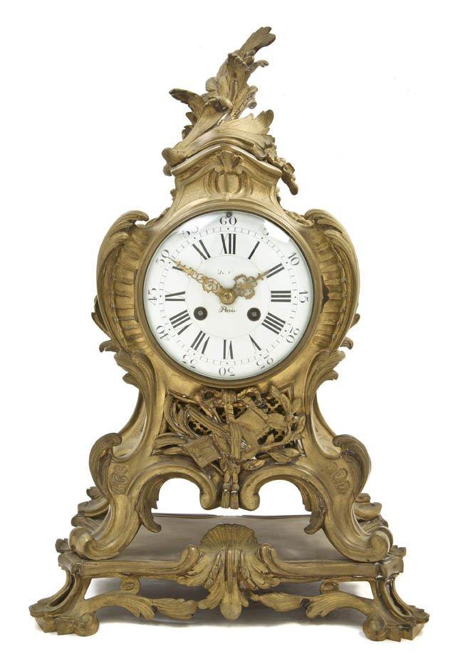 103: A Louis XVI Gilt Bronze Mantel Clock, Height 18 5/