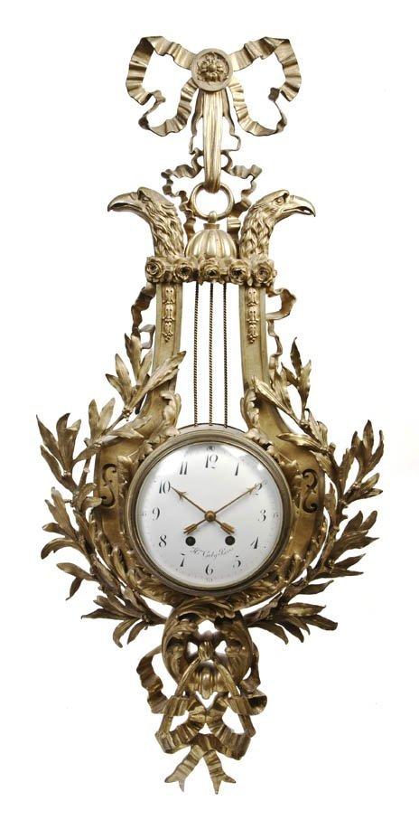 121: A Louis XVI Style Gilt Bronze Cartel Clock, Galy,
