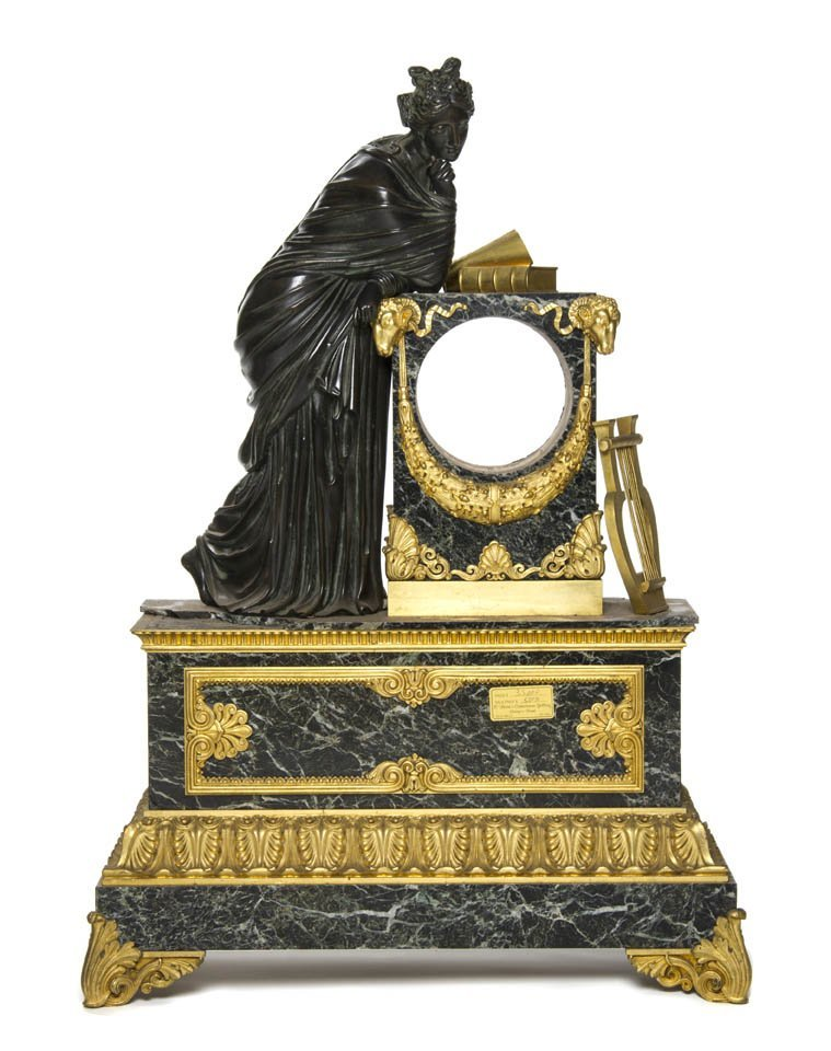 127: A French Gilt and Patinated Bronze Mounted Marble