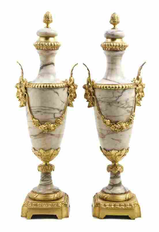 A Pair of Neoclassical Marble and Gilt Bronze Moun
