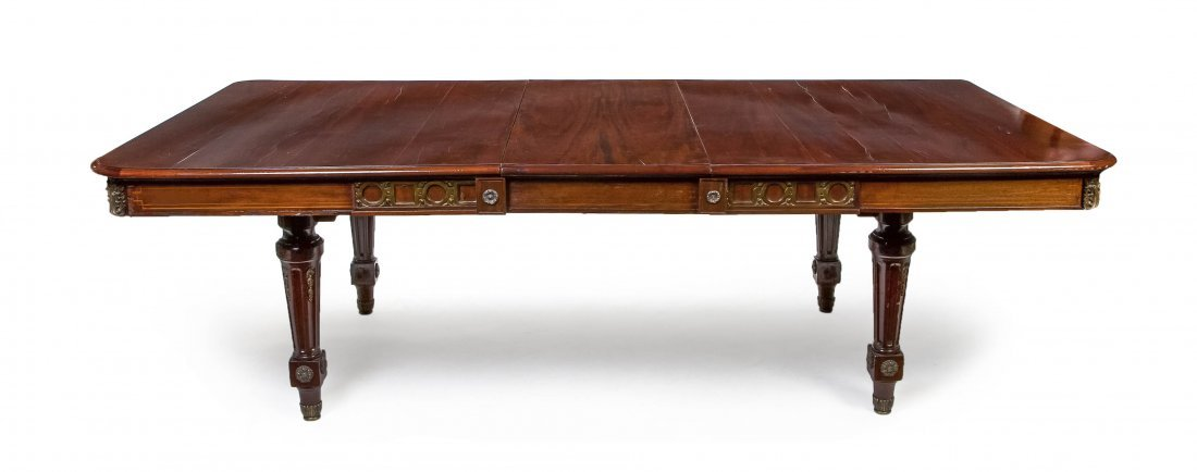 144: A Louis XVI Style Mahogany and Gilt Metal Mounted