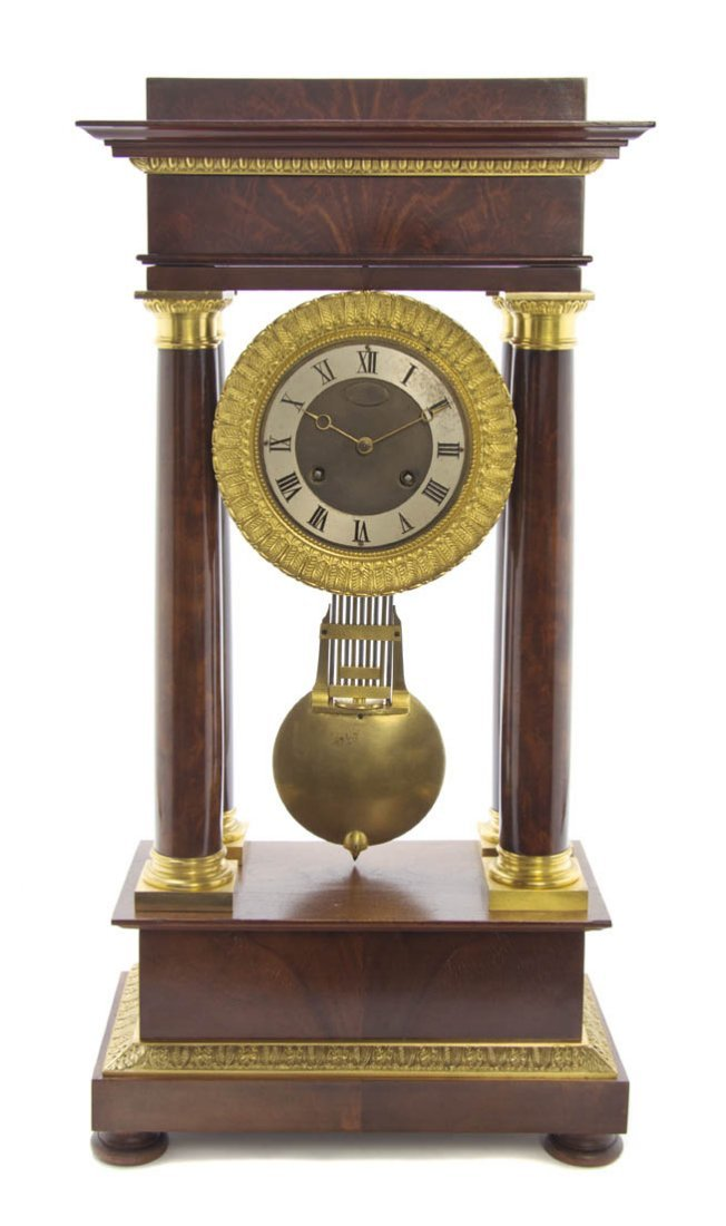 219: An Empire Style Mahogany and Gilt Bronze Mounted P