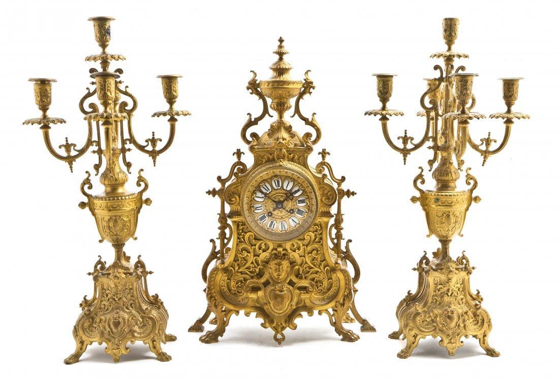 234: A French Neoclassical Gilt Bronze Clock Garniture,