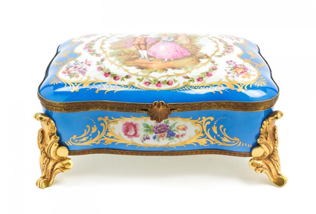 471: A Sevres Style Porcelain and Gilt Metal Mounted Ta