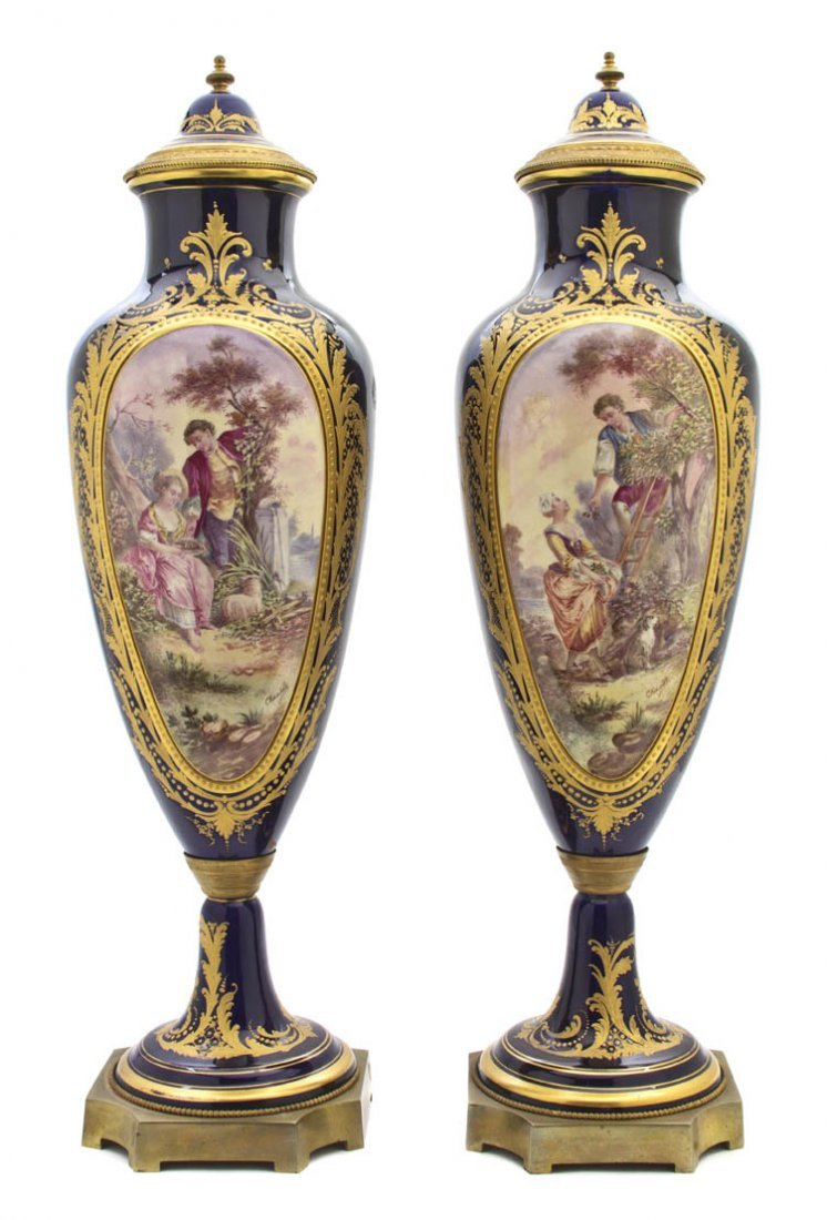 477: A Pair of Sevres Style Gilt Bronze Mounted Vases,