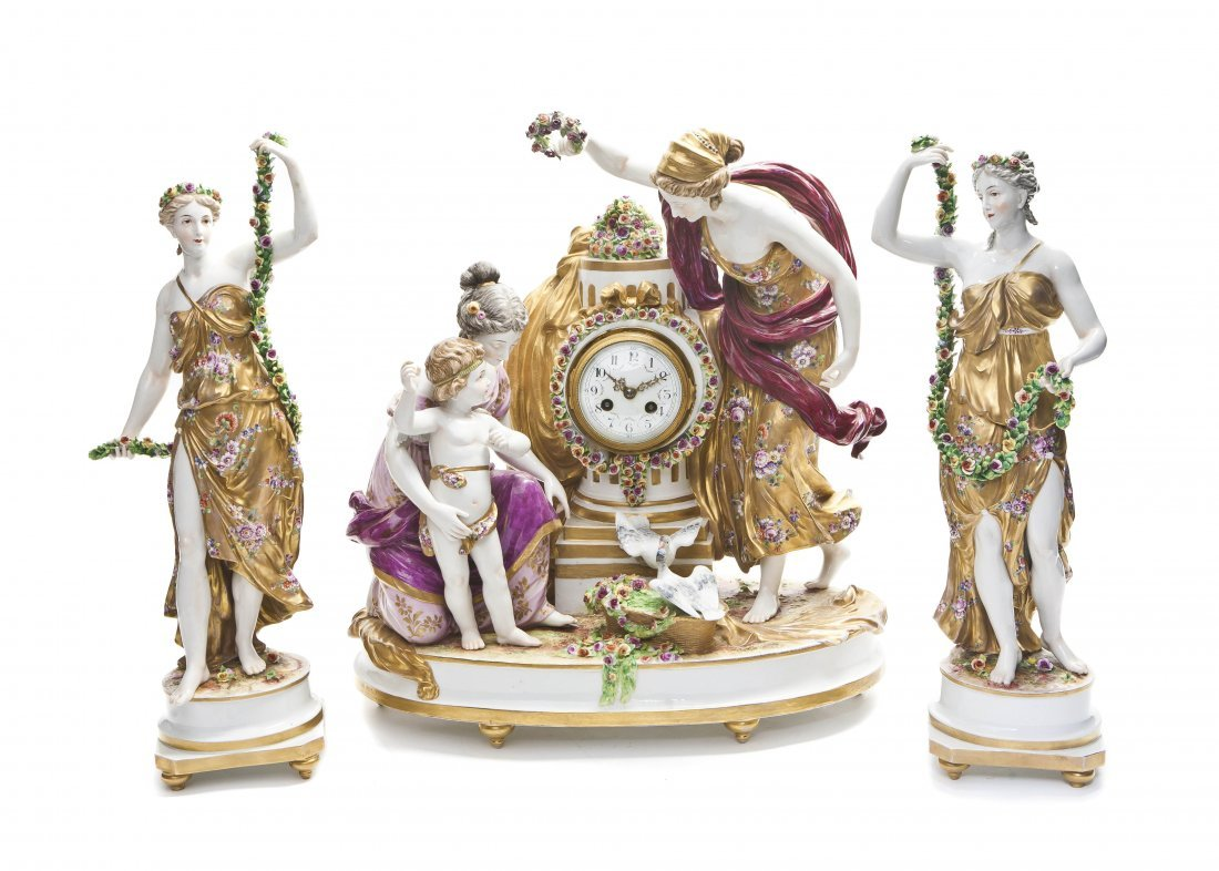 547: A German Porcelain Clock Garniture, Height of tall