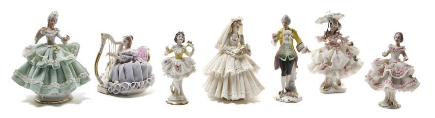 551: A Collection of Dresden Porcelain Lace Figurines,